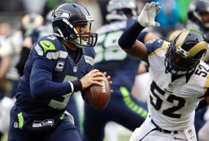 Alec Ogletree swarms Seattle QB Russell Wilson. (St. Louis Rams).