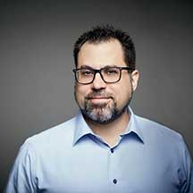 A headshot of Dan Adelman, Game Designer.