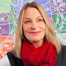 A headshot of Paula Scher, Graphic Designer.