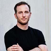 A headshot of Joe Gebbia, Designer.