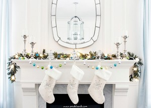Sleek-and-stylish-holiday-mantel-in-white-with-hints-of-blue
