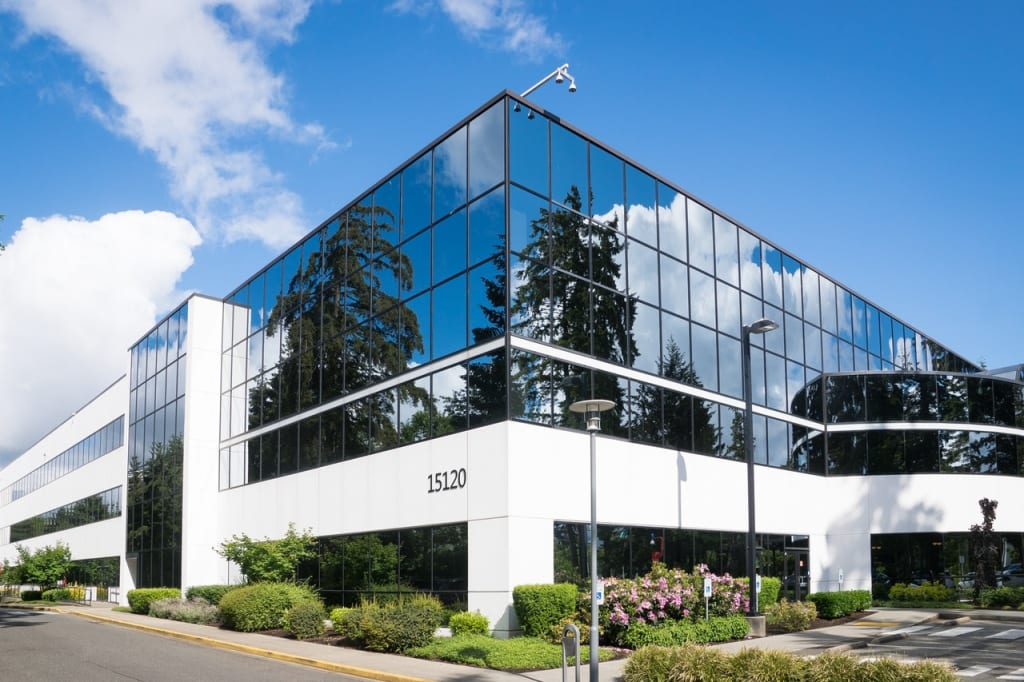 White commercial office building with glasses