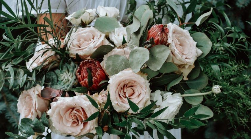 bucket of multicolor roses