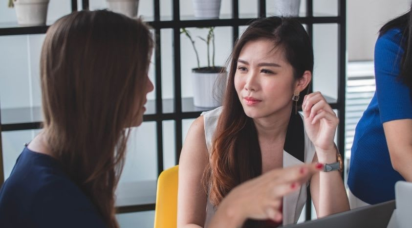 women having talk at the office