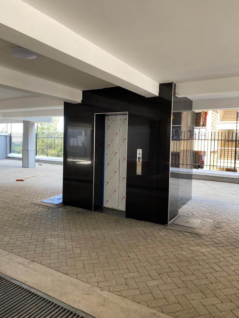 grandville luxury apartments phase 2 elevator lobby on the parking area