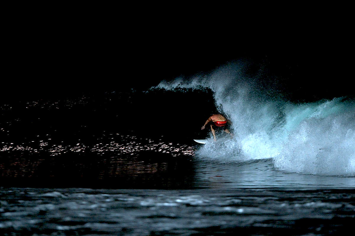 night surfer in a tube at the wave kerammas