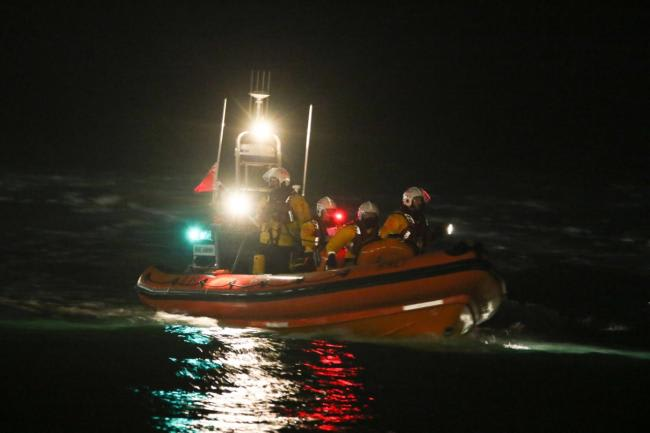 firefighter on boat with light for rescue