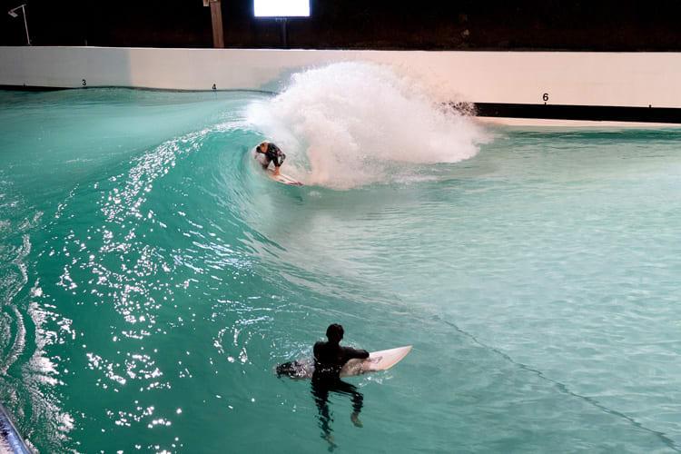 surfer in a wavepool by night