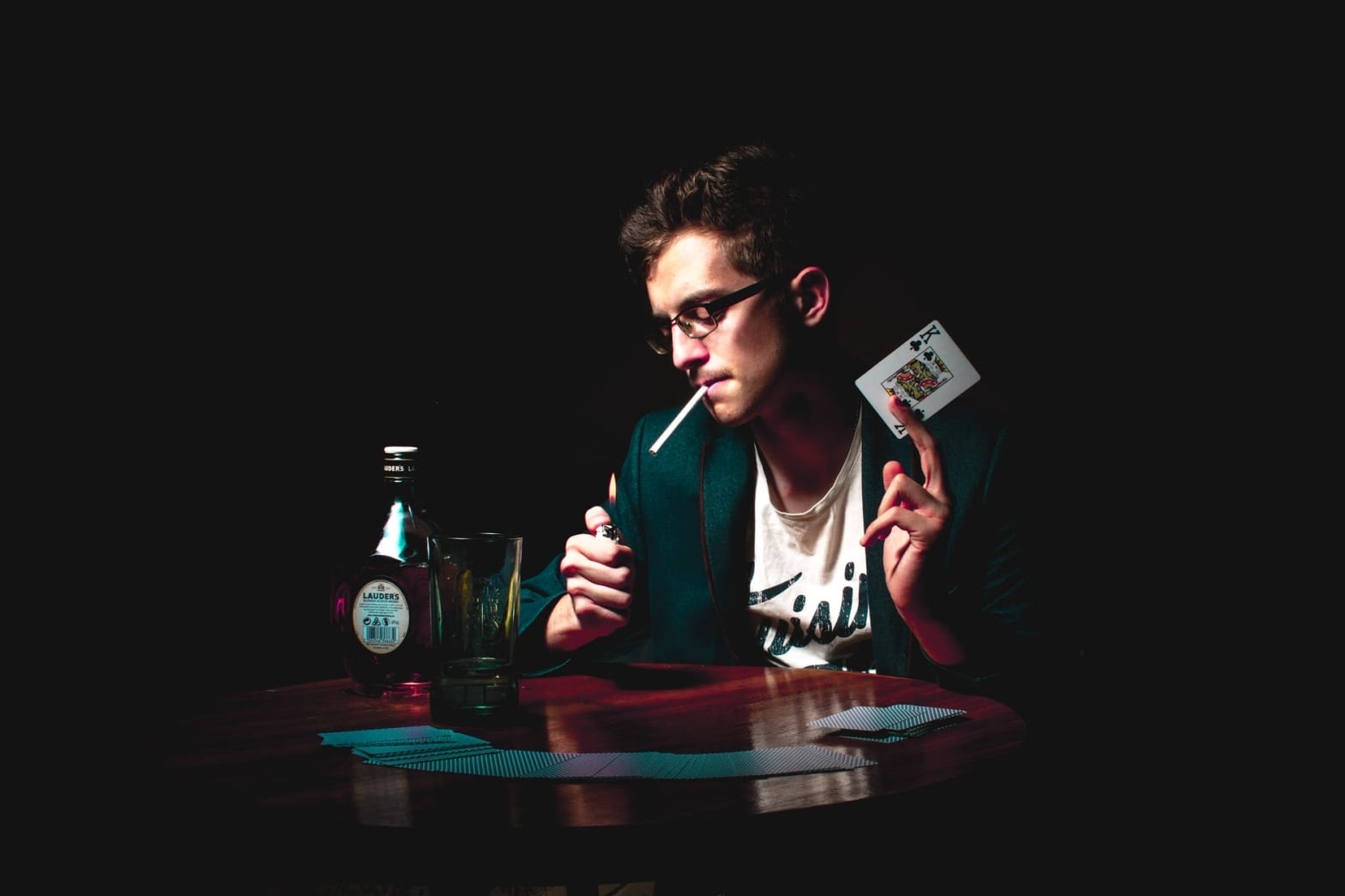 photo of man holding playing card
