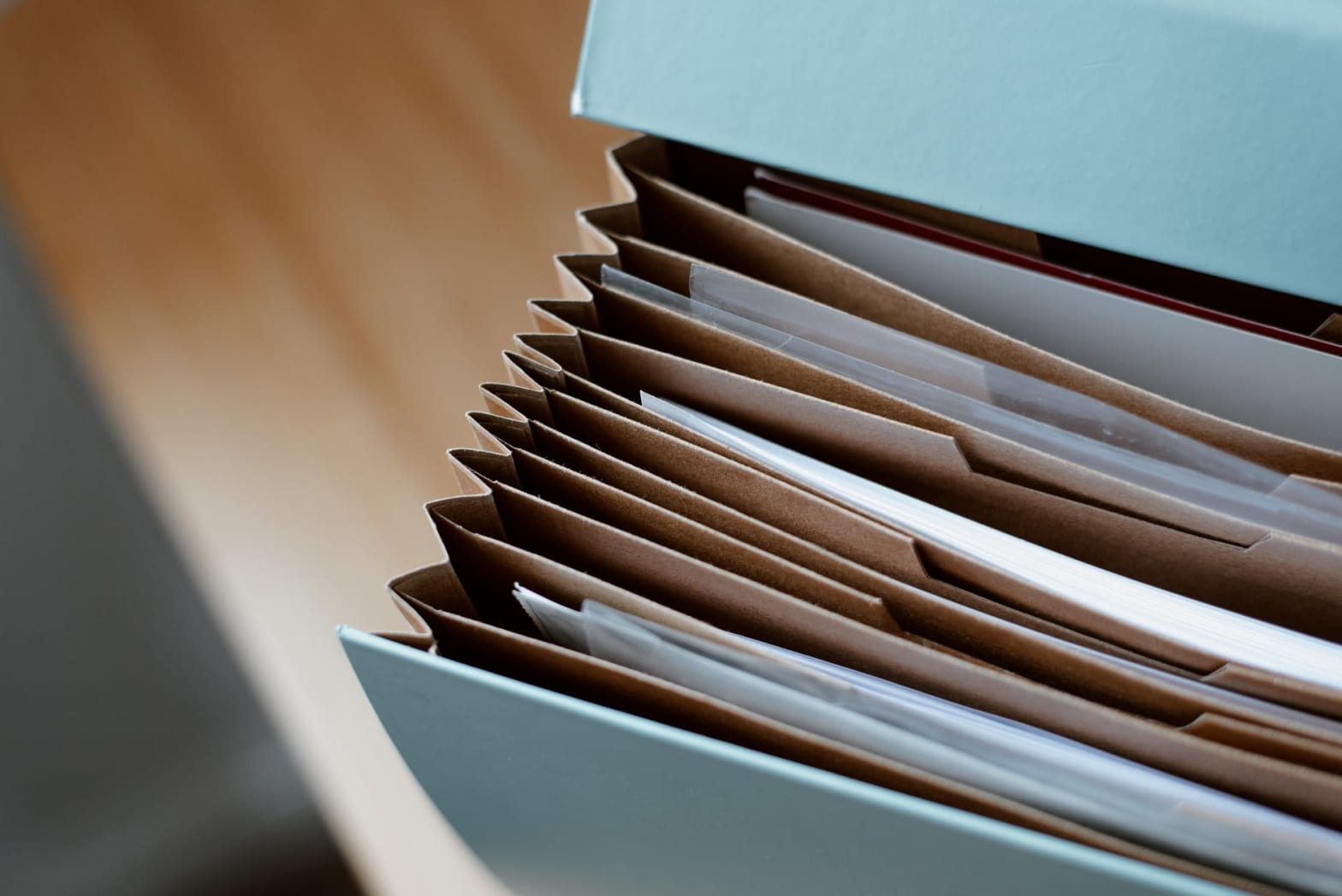 opened folder for documents on table