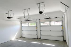 why does my garage door open by itself