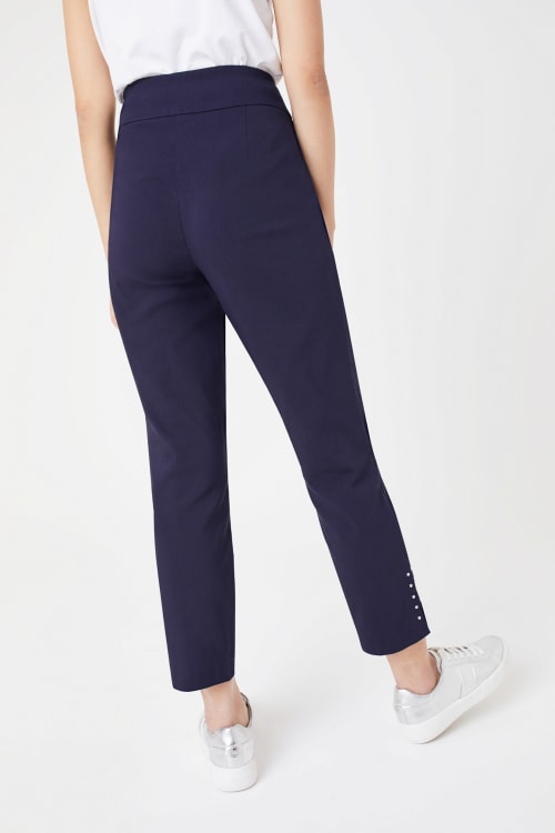 Roz & Ali Solid Superstretch Tummy Panel Pull On Ankle Pants With Rivet Trim Bottom - Back