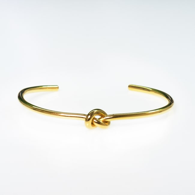 Dell Arte by Jean Claude Gold Plated Stainless Steel Knot Incrusted Bangle
