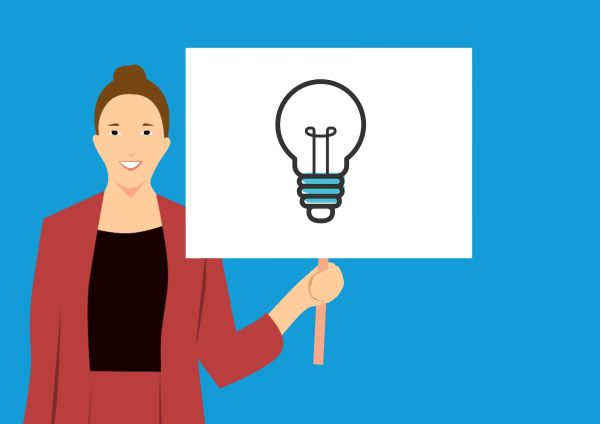 animated woman holding a sign with a light bulb on it
