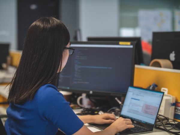 woman coding, custom software development