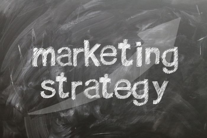 chalkboard writing that says 'marketing strategy'