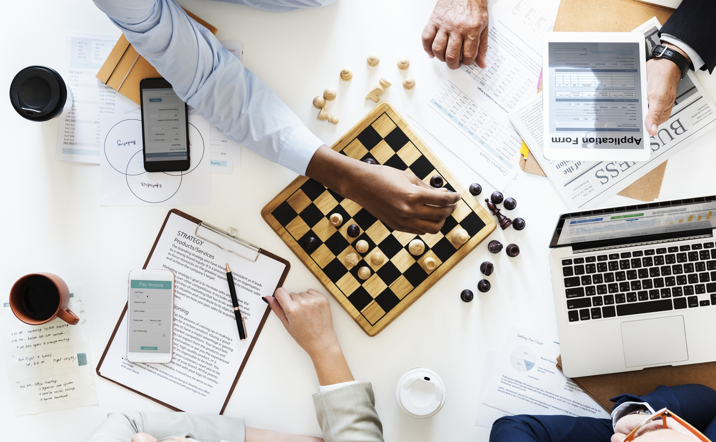 game of chess being played on business table