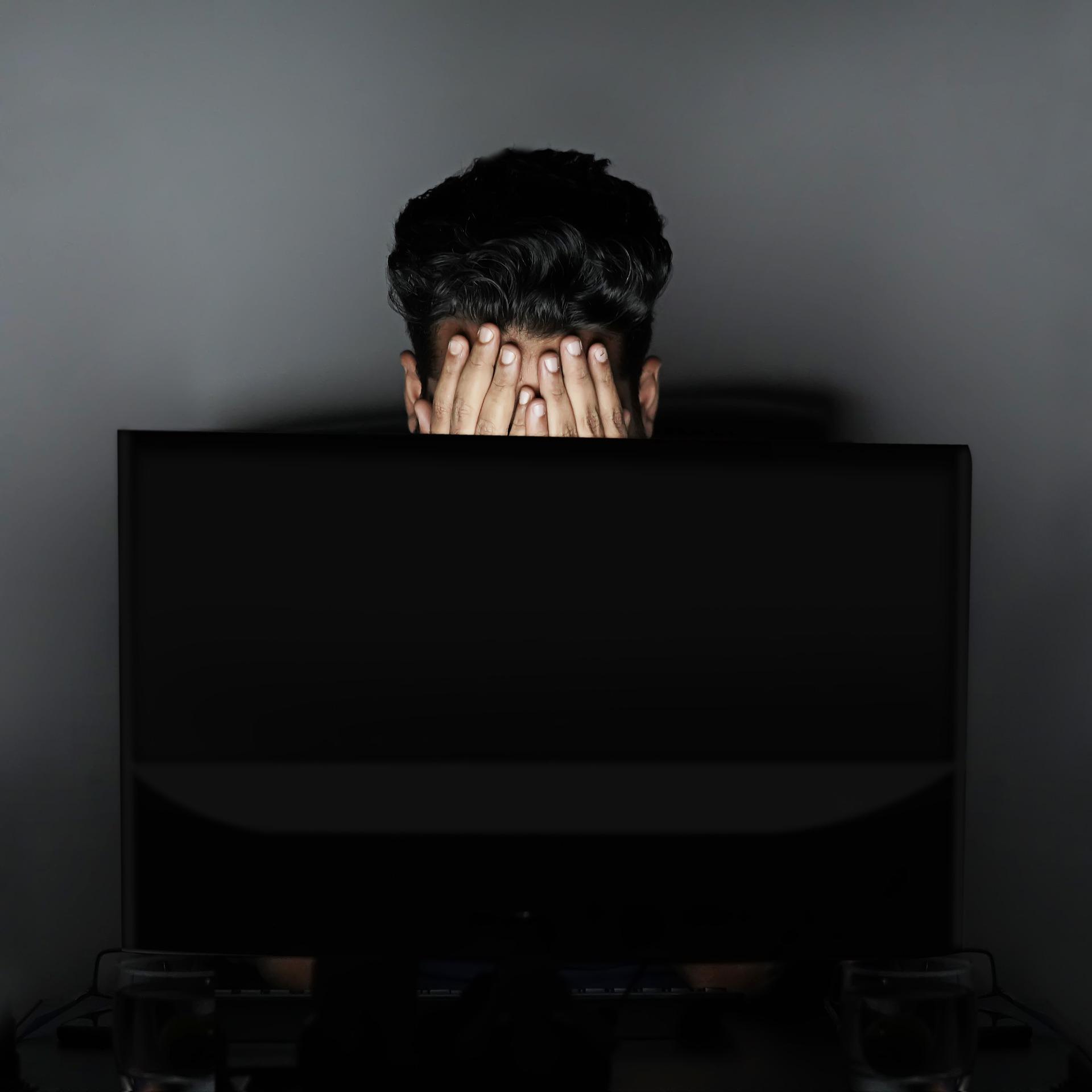Picture of a man mad at his computer screen