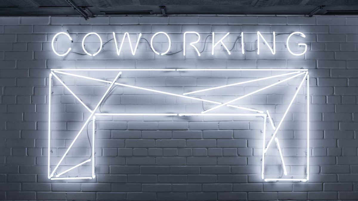 Neon sign that says 'Coworking'.