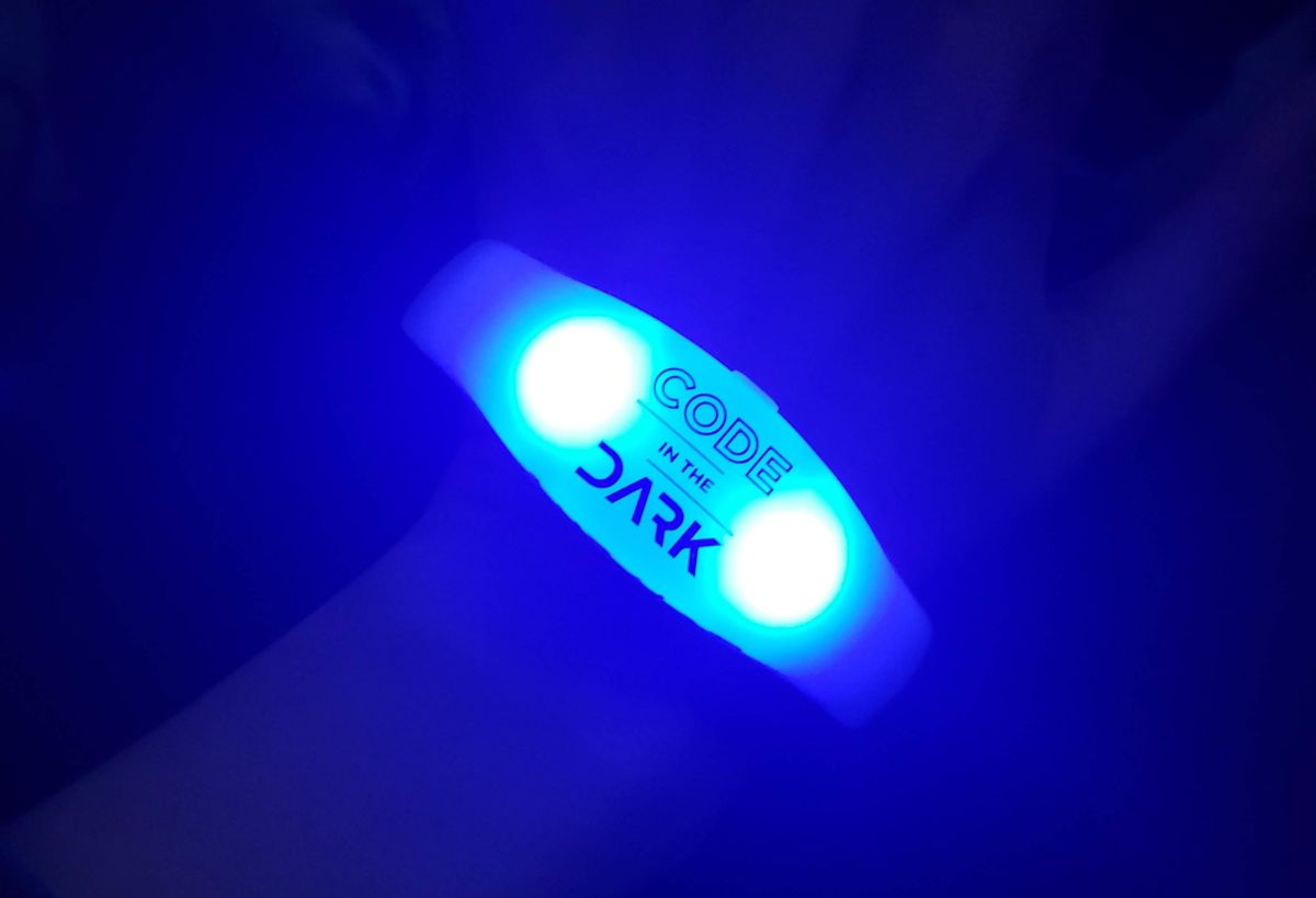 Code in the Dark branded light-up wristband.