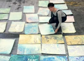 Woman with marbled paper spread out on the floor