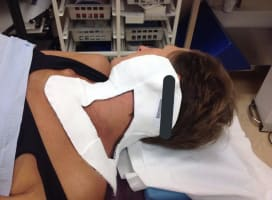 Jo Taylor with mask on to keep head still for radiotherapy.