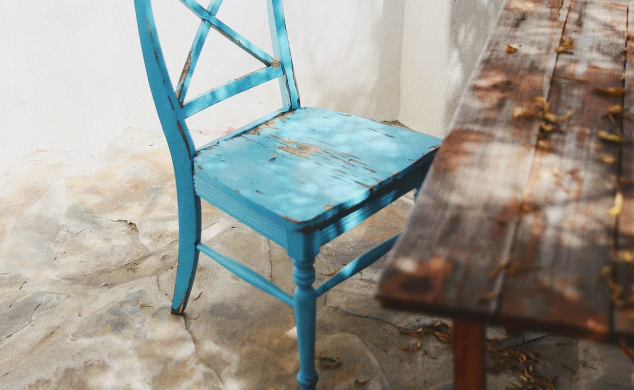 A blue wooden chair. Photo by Taylor Simpson.