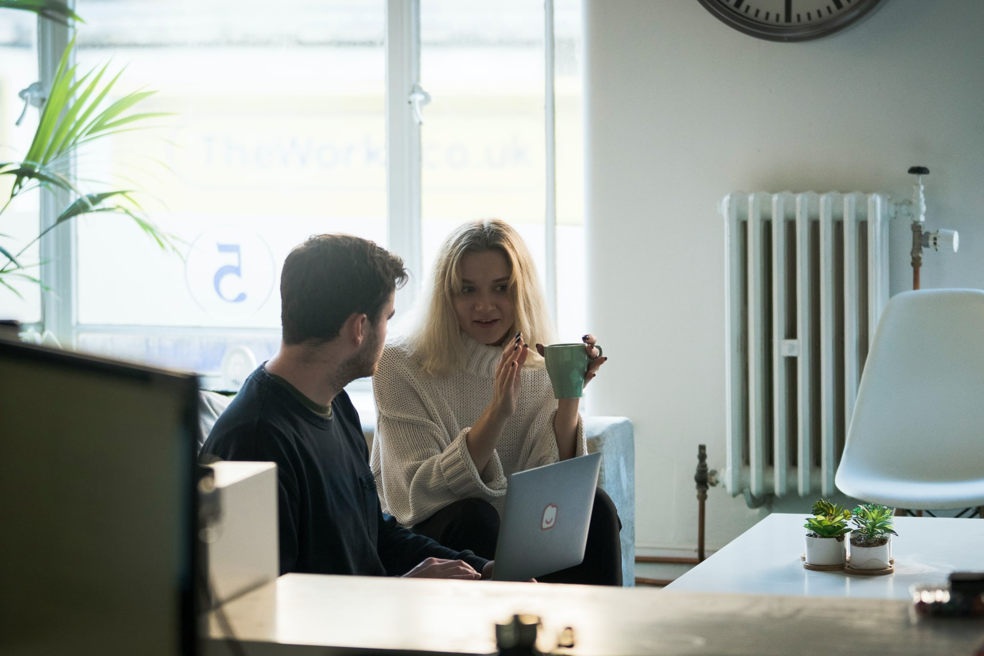 Man and woman in conversation in an office