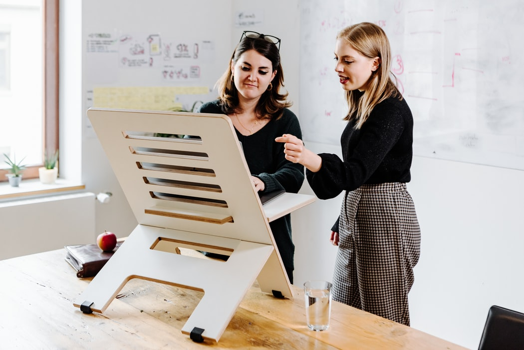 Women working upright on standing desk. Photo by Standsome Worklifestyle.