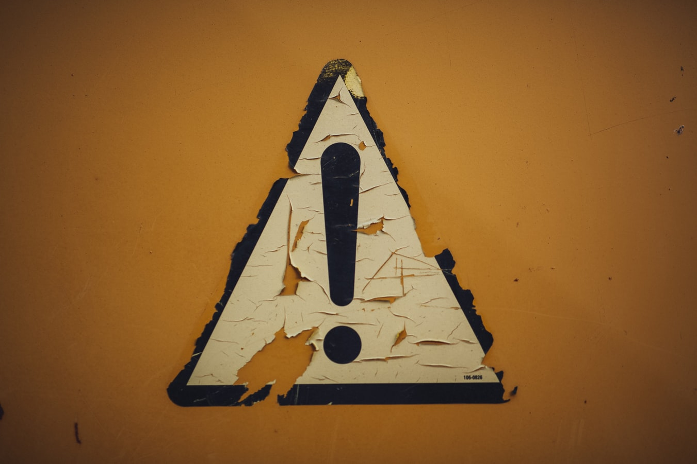 Caution sticker. Photo by Markus Spiske.