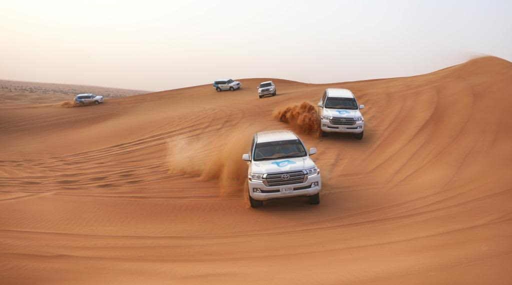 Abu Dhabi Desert Safari with BBQ, Camel Ride & Sandboarding