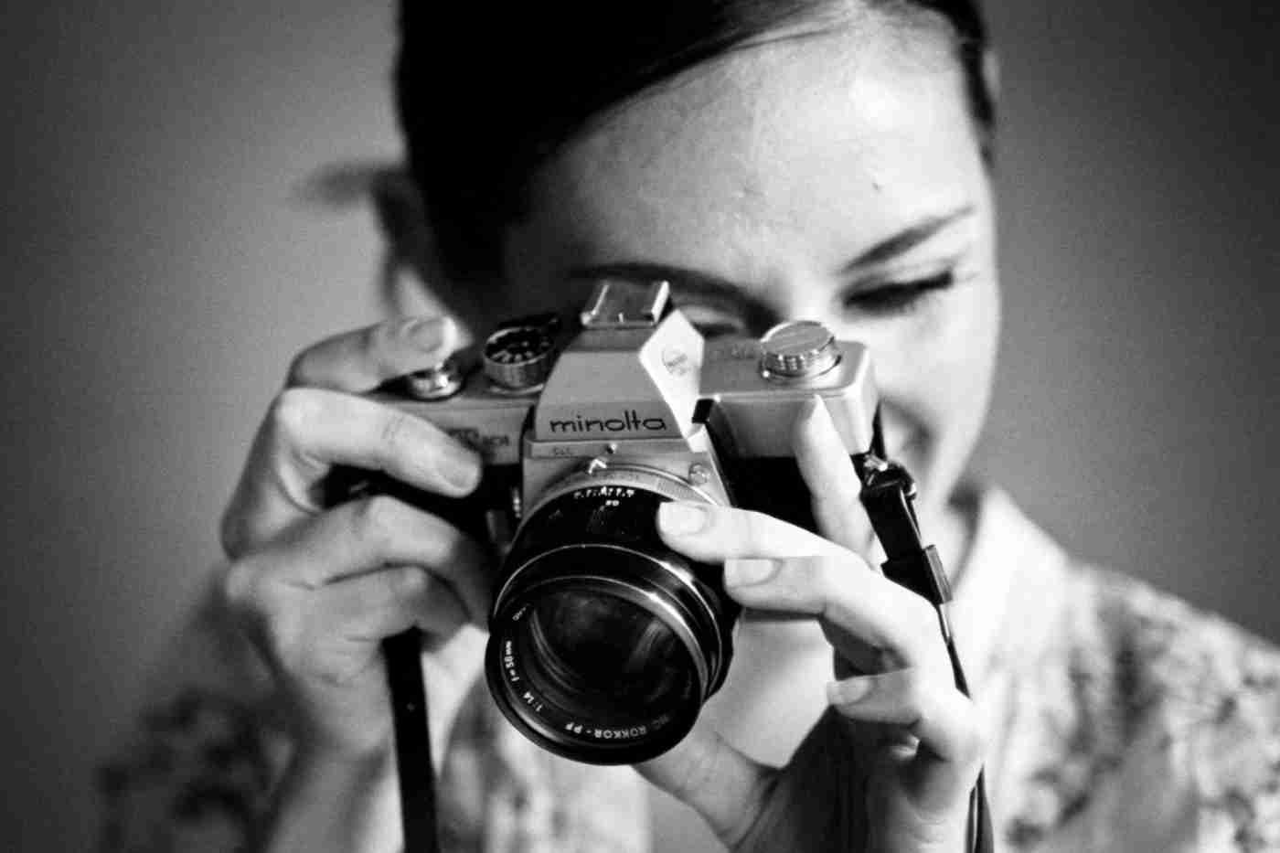 photographer with Minolta 35mm film SLR camera