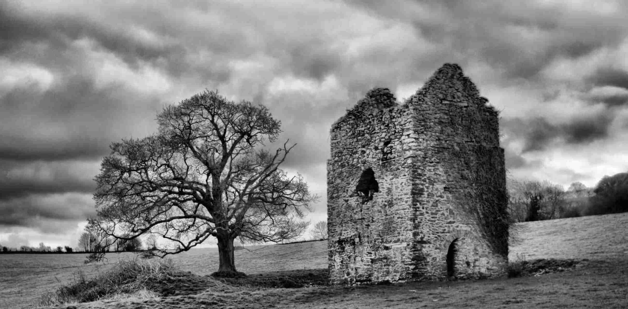 B&W photo of a derelict copper mine building in Somerset, England