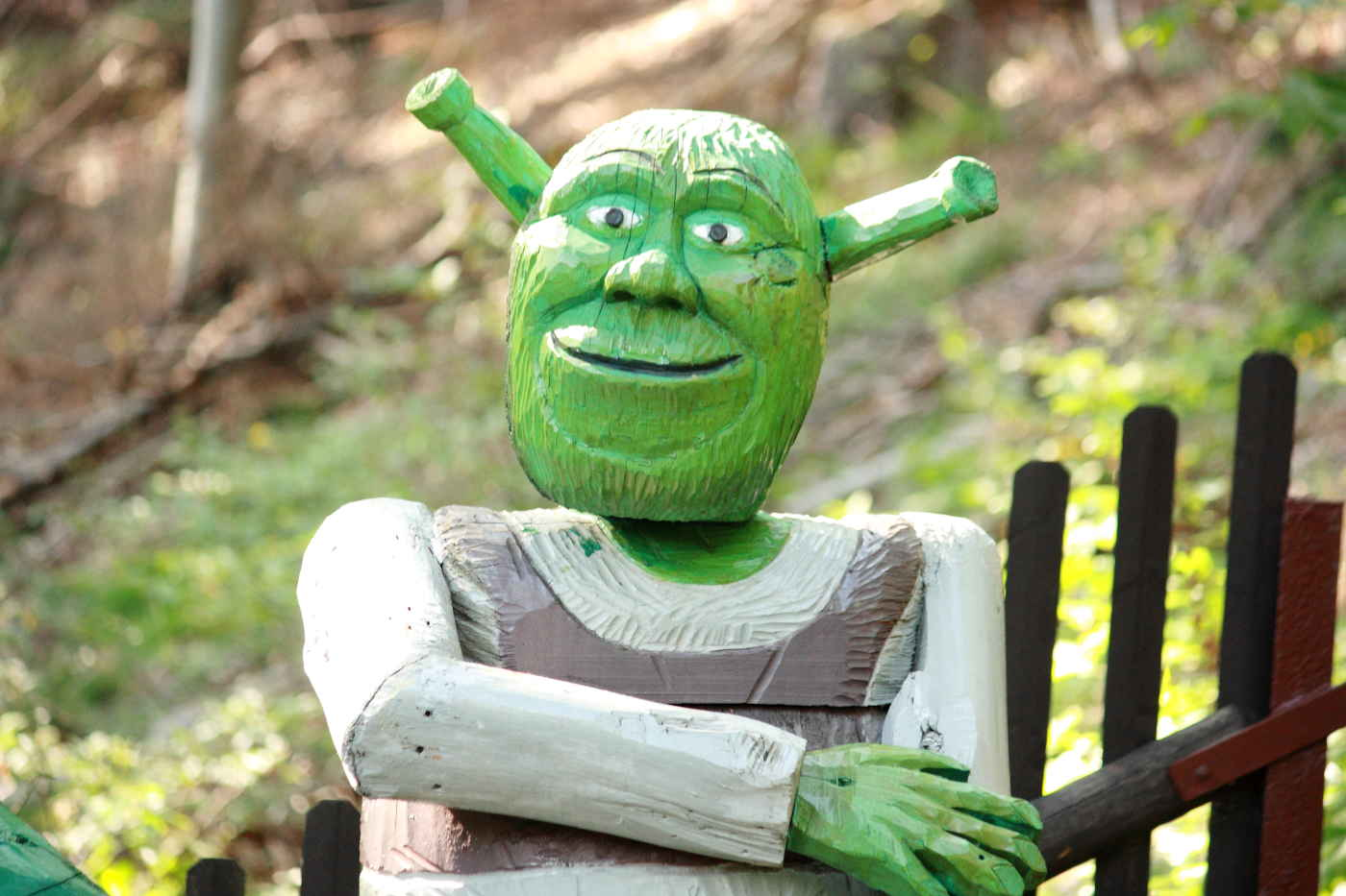 carved wooden likeness of the character Shrek