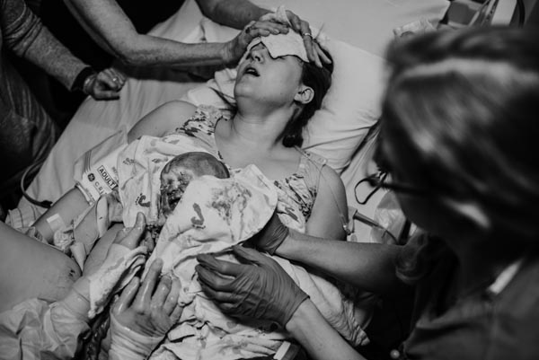 baby is placed on mother's chest immediately after birth