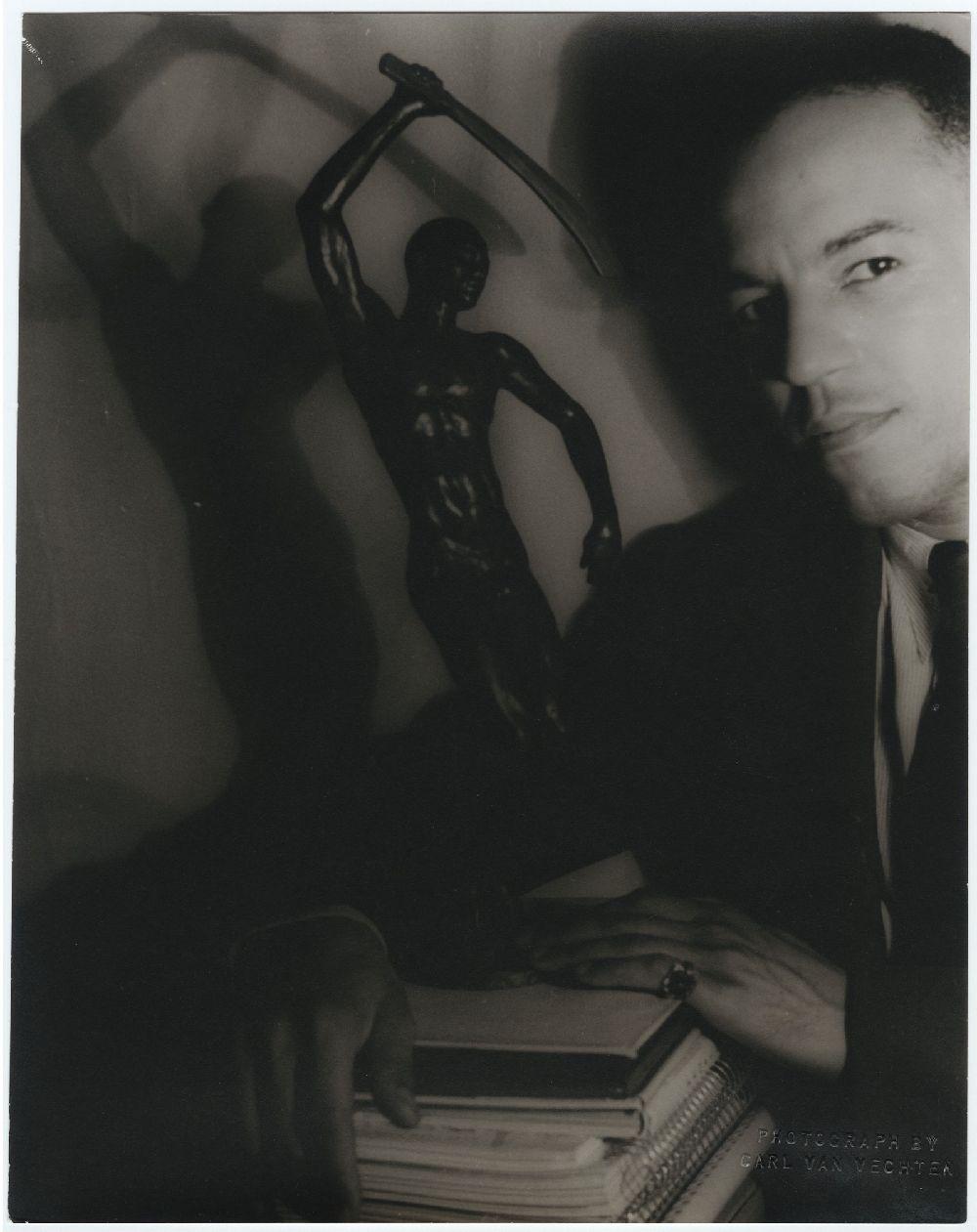 Richmond Barthé and his sculpture, Feral Benga, 1937.