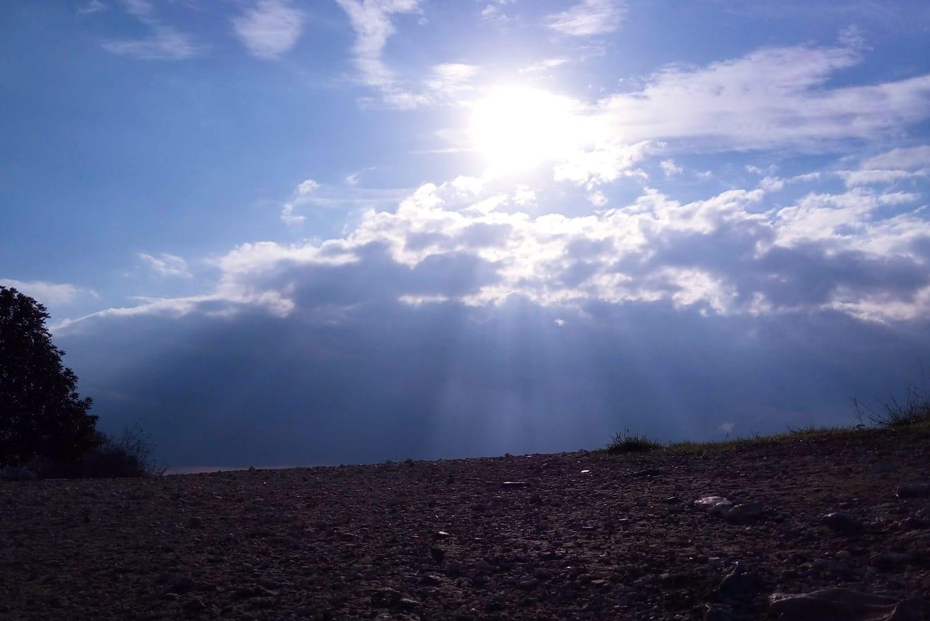 Bright Sun Rays Hitting the Dark Rocky Ground