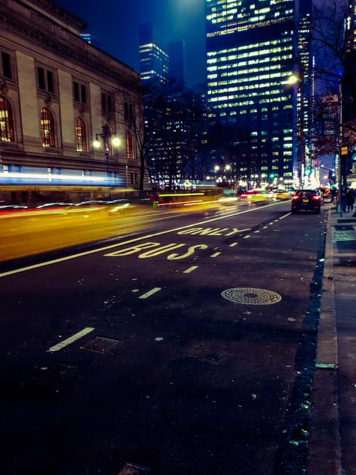 New York Taxis Speeding By in the Dark Night
