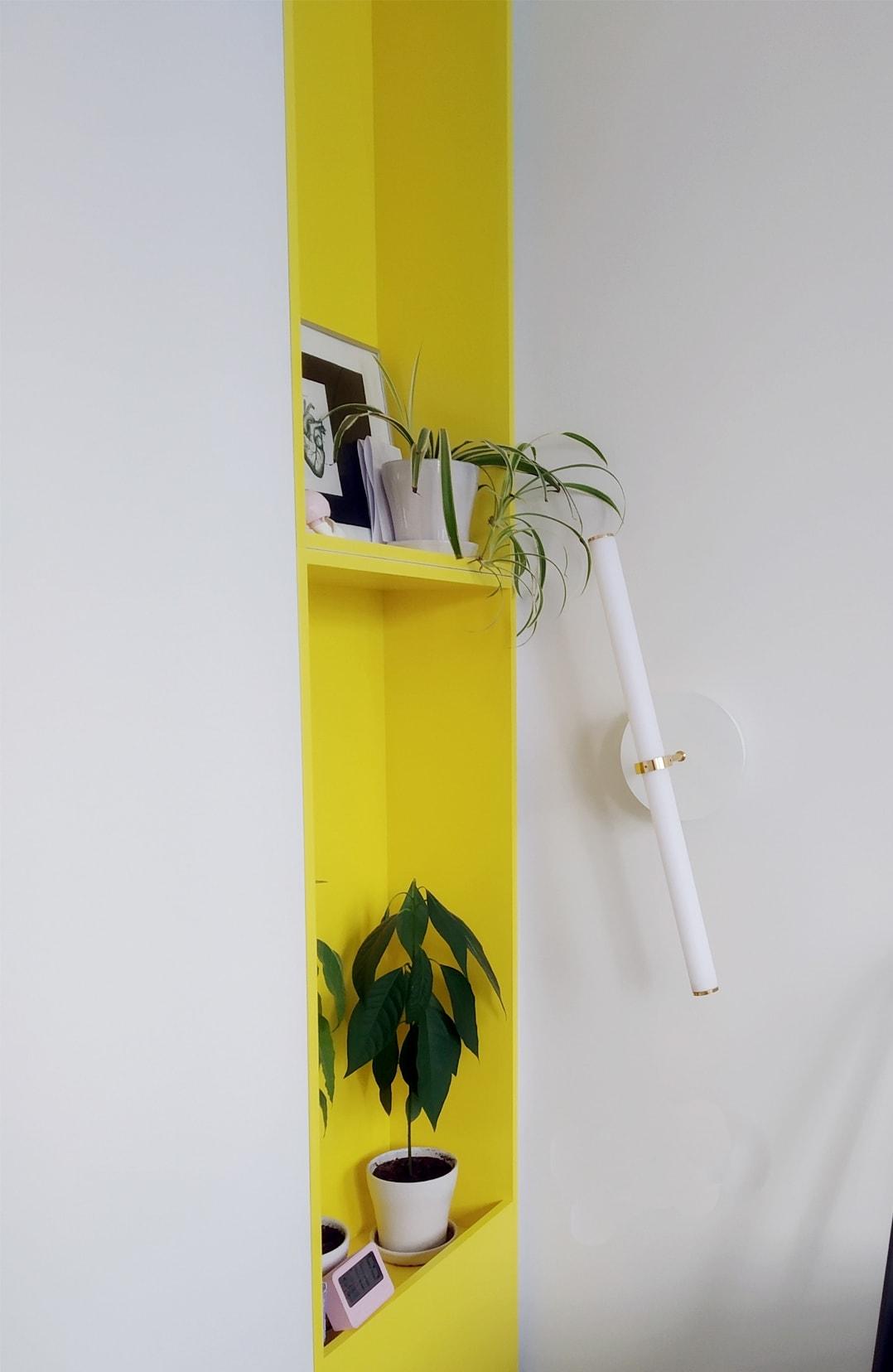 """Naama Hofman Light Objects 014 Brass and ivory wall yellow bookshelf"""