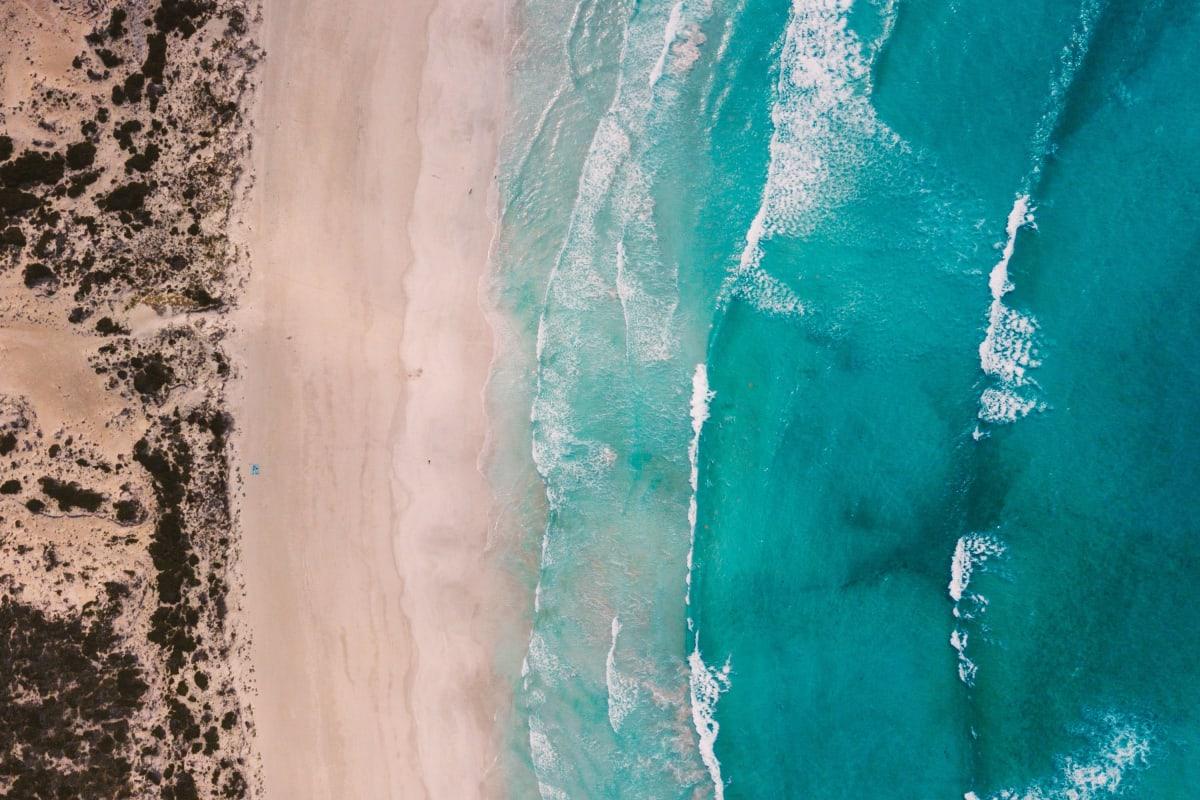 the point where the ocean meets the beach