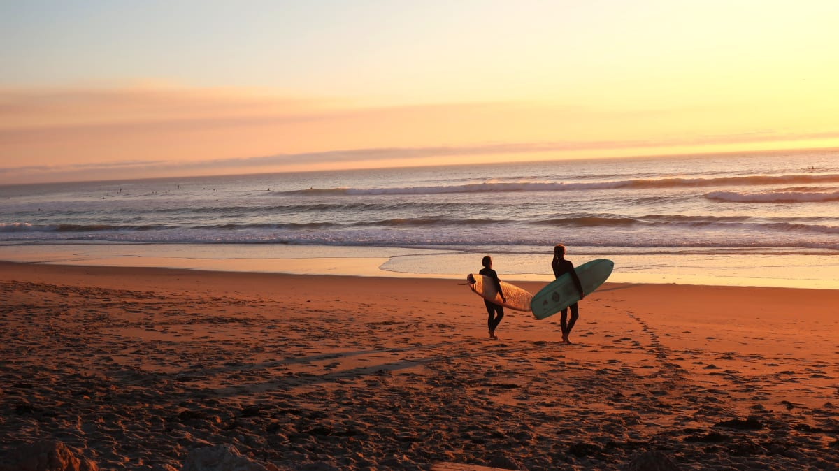 two surfers at the bach