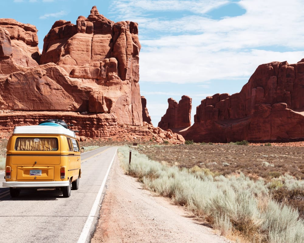 VW bus in front of a mountain range