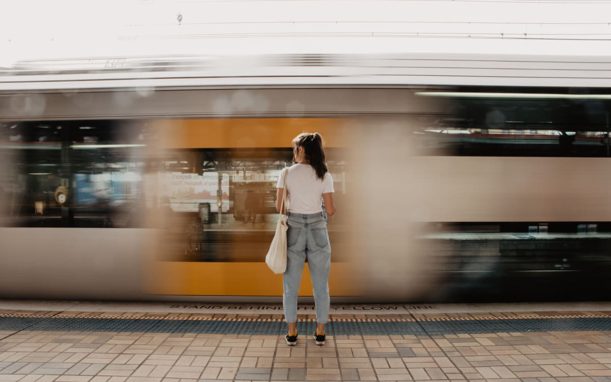 Girl in front of a moving train