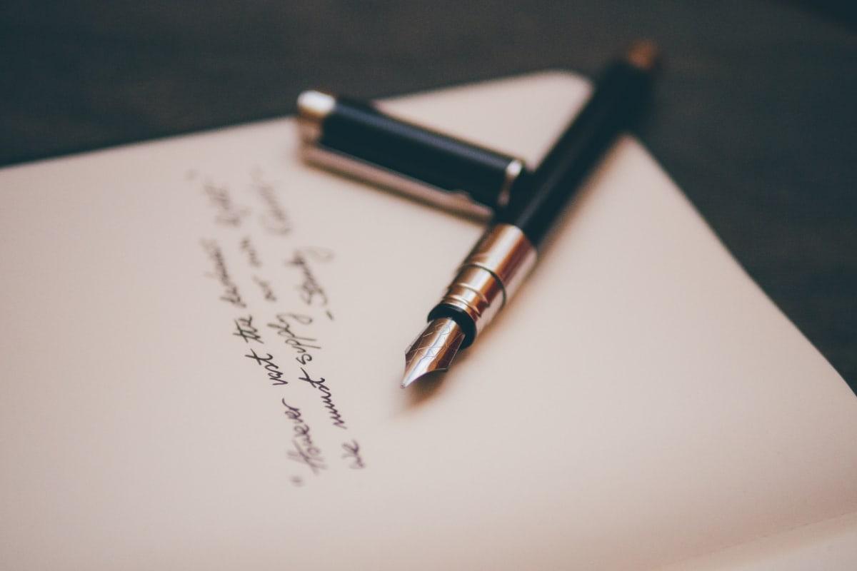 a pen lying inside a notebook