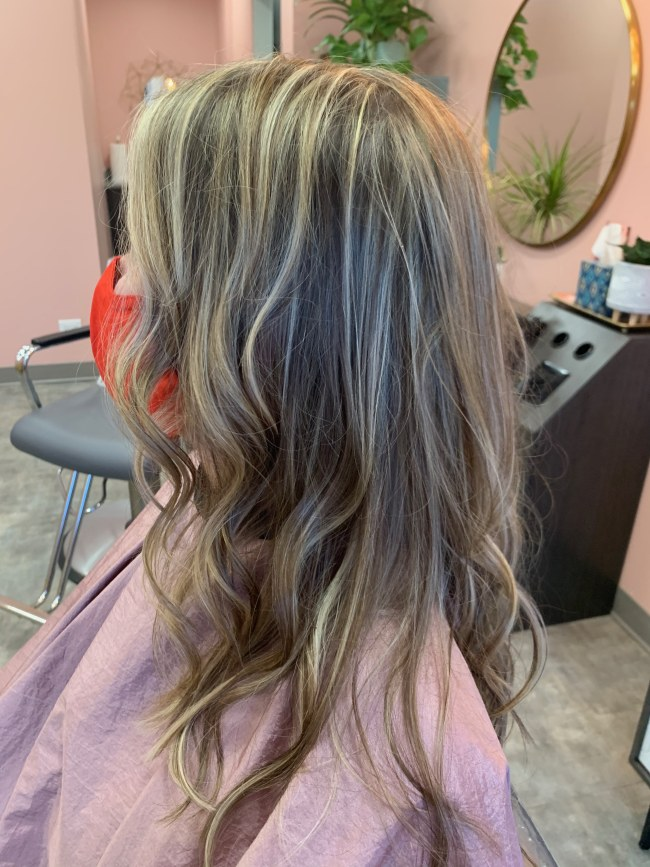 Hairstyle that showcases dimensional color with highlights and lowlights