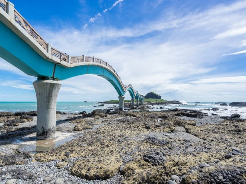 Day 2: Hike in Sanxiantai, whose long arched footbridge connects the rocky coast with a neighboring island.