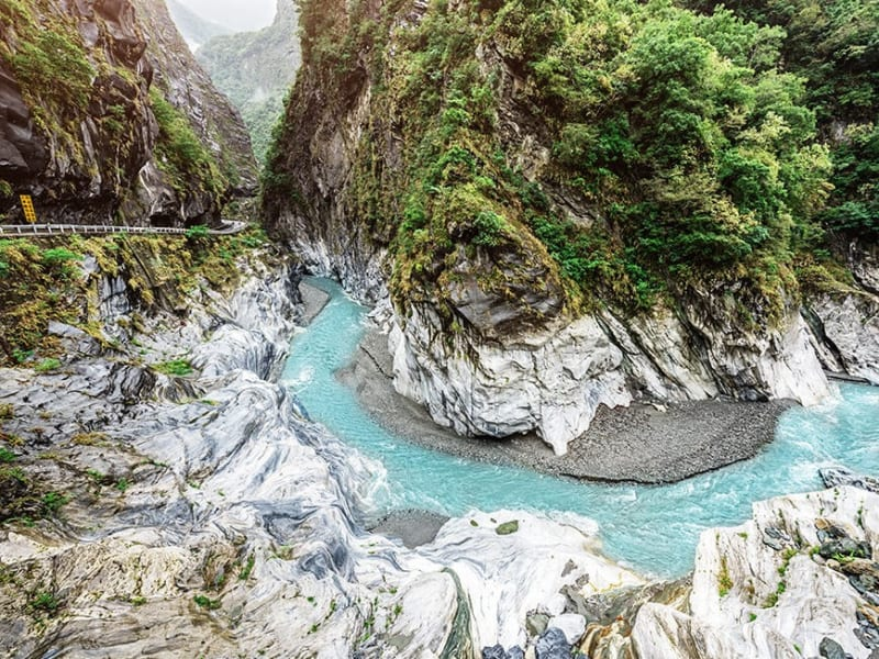Enjoy a guided tour of Taroko Gorge's spectacular mountains, marble canyons, gorges, rapid rivers, and stunning waterfalls