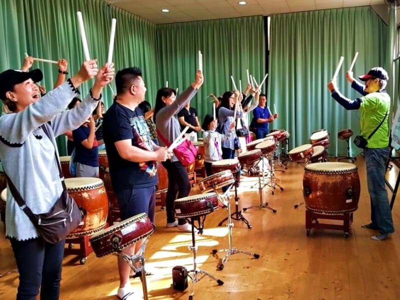 Take a traditional drumming class at the innovative Ten Drum Cultural Park (optional)
