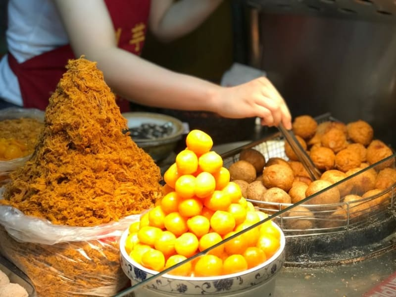 Sample Taiwanese snacks at the Ningxia Night Market