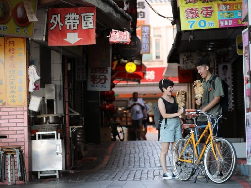 Explore Tamsui's old street by the wharf